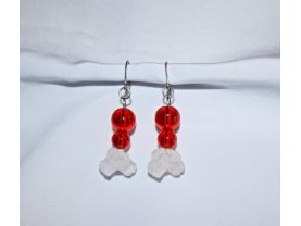 Handmade earrings of frosted white flower beads and sparkling red glass beads