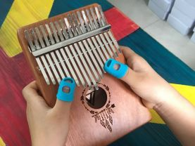 design new 17 key mbira thumb piano  Indian style arrow feather