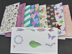 Floral and butterfly envelopes with 8 designer sheets of paper/cardstock group